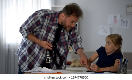 Inadequate dad screaming at daughter, holding strap, punishing for misbehavior