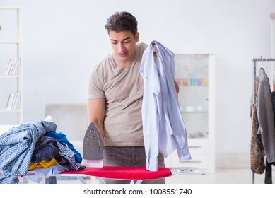 Inattentive husband burning clothing while ironing