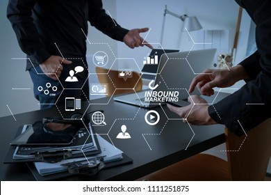 Inbound marketing business with virtual diagram dashboard and Online or permission market concept.co working meeting,two businessman using VOIP headset with latop computer on desk in modern office.