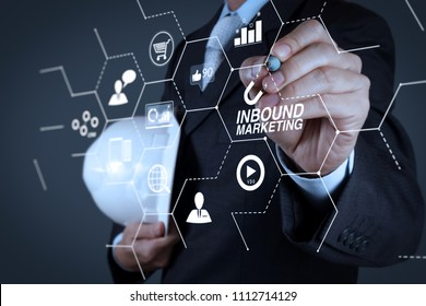 Inbound marketing business with virtual diagram dashboard and Online or permission market concept.businessman hand writing in the whiteboard or virtual screen