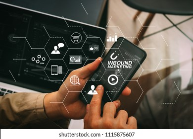 Inbound marketing business with virtual diagram dashboard and Online or permission market concept.hand using smart phone and digital tablet computer for online banking payment communication.
