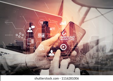 Inbound marketing business with virtual diagram dashboard and Online or permission market concept.Double exposure of hand using smart phone and digital tablet computer for online banking payment.