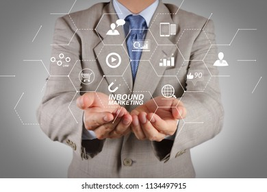 Inbound marketing business with virtual diagram dashboard and Online or permission market concept.business man with an open hand as showing something concept
