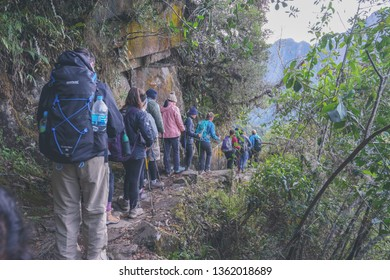 Inca trail, Peru - August 14th, 2018: Tourist are lining up on the famous Inca trail. They are on their way to Machu Picchu in Peru.