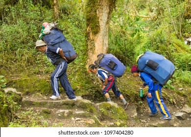 Inca Trail, Peur - 11/3/2016:  Peruvian porters with their loaded packs carrying camping gear for hikers on the Inca Trail, their destination Machu Picchu.