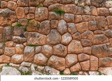 Inca wall in the ruins of Chinchero in Peru.