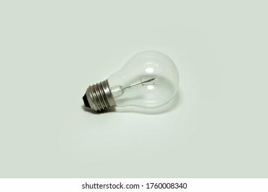 incandescent bulb on  a white backgound. incandescent lamp, incandescent light globe. energy concept.