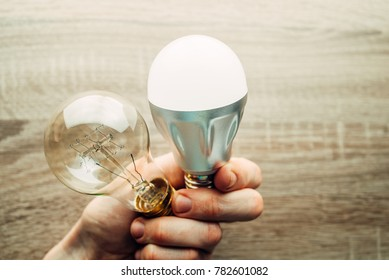 Incandescent light bulb and LED lamp being compared