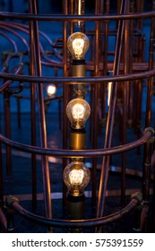 Incandescent light bulbs surrounded by pipes