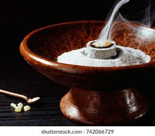 incense bowl and burning incense
