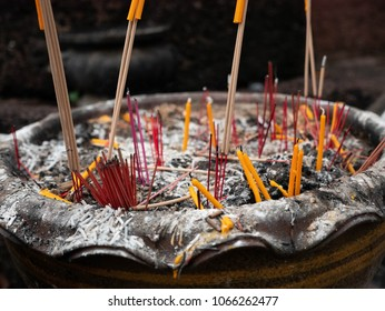 An incense burner filled with incense and candles. To pay respect to the Buddha. Or to pay homage to the shrine