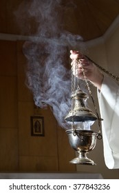 Incense burner held by a catholic priest.