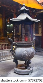 An incense burner in a traditional Chinese temple, where people burn incense and paper money to honor their families and ancestors