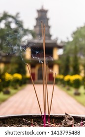 Incense burns in an urn to honour ancesters at Chùa Thiên Mụ (Pagoda of the Celestial Lady, also called Linh Mụ Pagoda) , Huế, Vietnam.