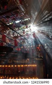 Incense coils and smoke inside Man Mo Temple, Hollywood Road, Hong Kong