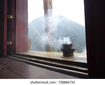 Incense in door of Buddhist temple in Upper Pisang, Nepal, Annapurna Circuit trek