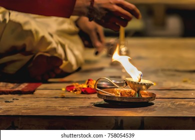 Incense, flowers and light at the Aarti celebrations of light on the river Ganges is a Hindu religious ritual of worship taking place in Varanasi, India.