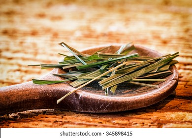 Incense on an old kitchen spoon - sweetgrass