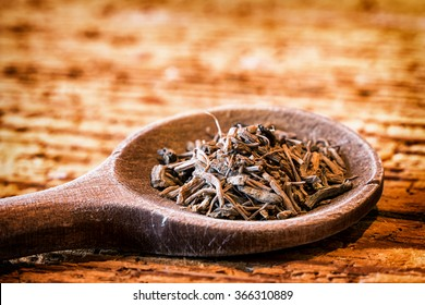 Incense on an old kitchen spoon - valerian root