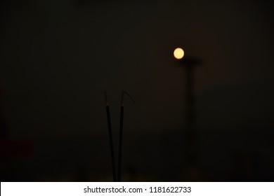 Incense stick black background