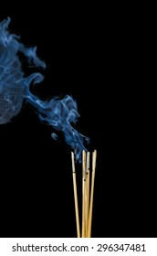 Incense Stick with Smoke on Black Background.