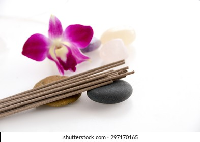 incense sticks with orchid flower on white background