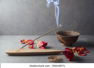 incense sticks with rose flowers leaves