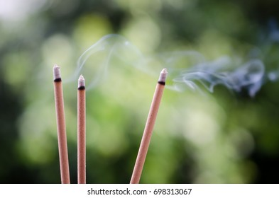 Incense sticks and smoke from incense burning.Incense to worship what respect.