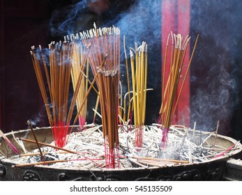 incense sticks at The Temple of the Jade Mountain  in Hanoi, Vietnam. Incense is aromatic biotic material which releases fragrant smoke when burned.