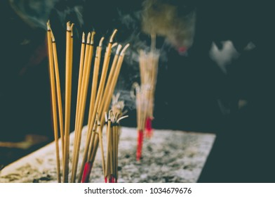 Incense sticks until burning and smoke. To worship the sacred. Respect for the Buddha is the belief of Thai Buddhists.
