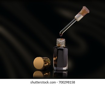 Incense Of Traditional Arabian Fragrance Oud Oil And Dropper With Droplet Made Of Agar Wood In A Glass Jar Isolated On Black Background