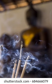 incense worship Buddha statue