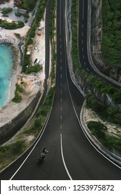 Inception photo landscape. Motorbike go on the road, shoot from a drone