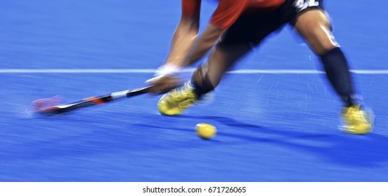 INCHEON, Korea, 30 September 2014: Panning. Slow speed. Motion blur. Field hockey players control the ball at Seonhak Hockey Stadium, at Asian Games 2014, Incheon, Korea.