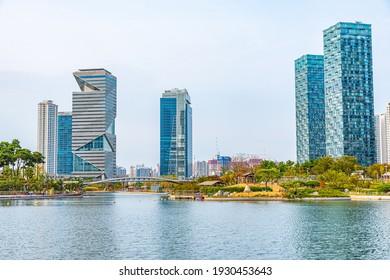 INCHEON, KOREA, OCTOBER 25, 2019: Skyscrapers surrounding Songdo Central park at Incheon, Republic of Korea