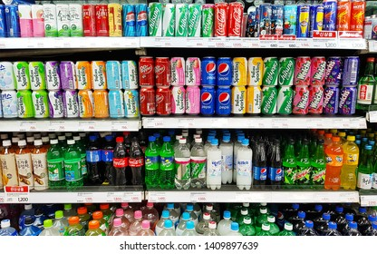 Incheon, KR - MAY 7, 2019: Various colorful soft drinks, fruits juices and soda cans that are on shelf in a supermarket.