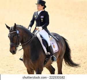 INCHEON - SEP 20:PRINCESS Sirivannavarinariratana of Thailand participates in 2014 Incheon Asian Games at Dressage Team Prix St-Georges on September 20, 2014 in Incheon, South Korea.