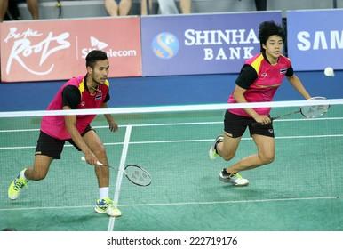 INCHEON - SEP 26:Maneepong JONGJIT and Sapsiree  TAERATTANACHAI of Thailand participates in 2014 Incheon Asian Games at Gyeyang Gymnasium on September 26, 2014 in Incheon, South Korea.