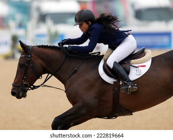 INCHEON - SEP 28:CHEW Yen Tung Catherine Marissa of Singapore in action during the 2014 Incheon Asian Games at Dream Park Equestrian Venue on September 28, 2014 in Incheon, South Korea.