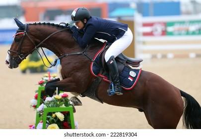 INCHEON - SEP 28:HAMIDJOJO Diah Wulandari of India  in action during the 2014 Incheon Asian Games at Dream Park Equestrian Venue on September 28, 2014 in Incheon, South Korea.