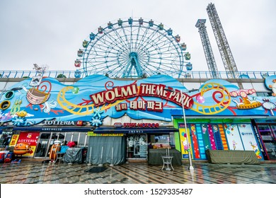 Incheon South Korea , 7 October 2019 : Wolmi theme park entrance with view of the ferris wheel on wolmido island in Incheon South Korea