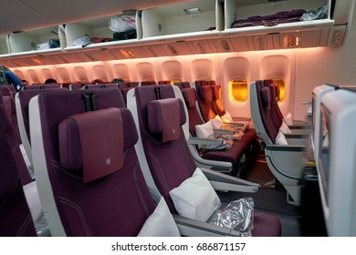 INCHEON, SOUTH KOREA - CIRCA JUNE, 2017: inside Qatar Airways Boeing 777. Qatar Airways, is the state-owned flag carrier of Qatar.