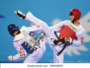 INCHEON,SOUTH KOREA - OCT 02: LEE Daehoon (r) of South Korea in action during Men's -63 kg Taekwondo final of the 2014 Asian Games at Ganghwa Dolmens Gym on October 02, 2014 in Incheon, South Korea.