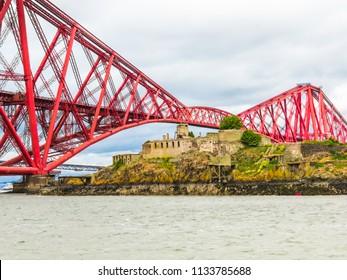 Inchgarvie Island in the Firth of Forth and Old Forth Bridge. Edinburgh, Scotland, UK
