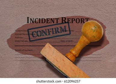 Incident report form and a wooden stamp on grunge background