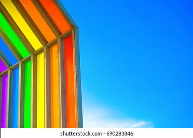 Inclined lines abstract colorful rainbow perspective / can used look like a rainbow  symbolism mean in the bible that is a symbol of lesbian, gay, bisexual, (LGBT) pride on the blue sky background