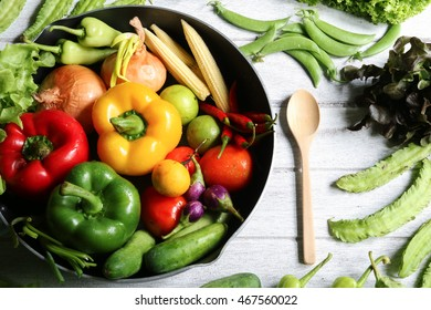 Include fresh organic vegetables in a pan on white wooden floor. concept  clean, healthy food