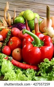 Include vegetables on wooden floor