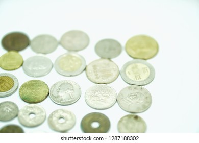 Including coins of each country, high-angle white backdrop