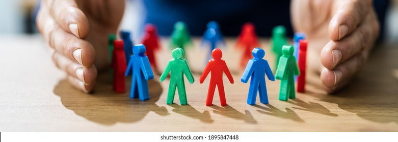 Inclusion And Diversity. Hand Protecting Inclusive Equal Pawns